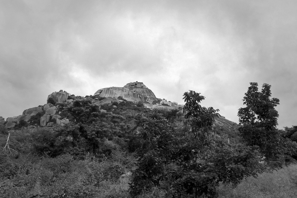 The stunning rocky outcrops along with the monsoon clouds provide a dramatic backdrop to the Koppal landscape. ​
